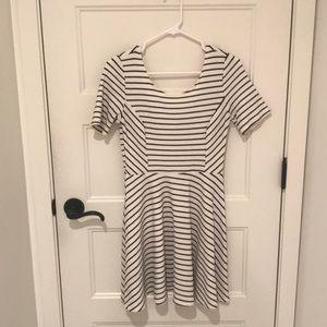 white dress with black stripes.